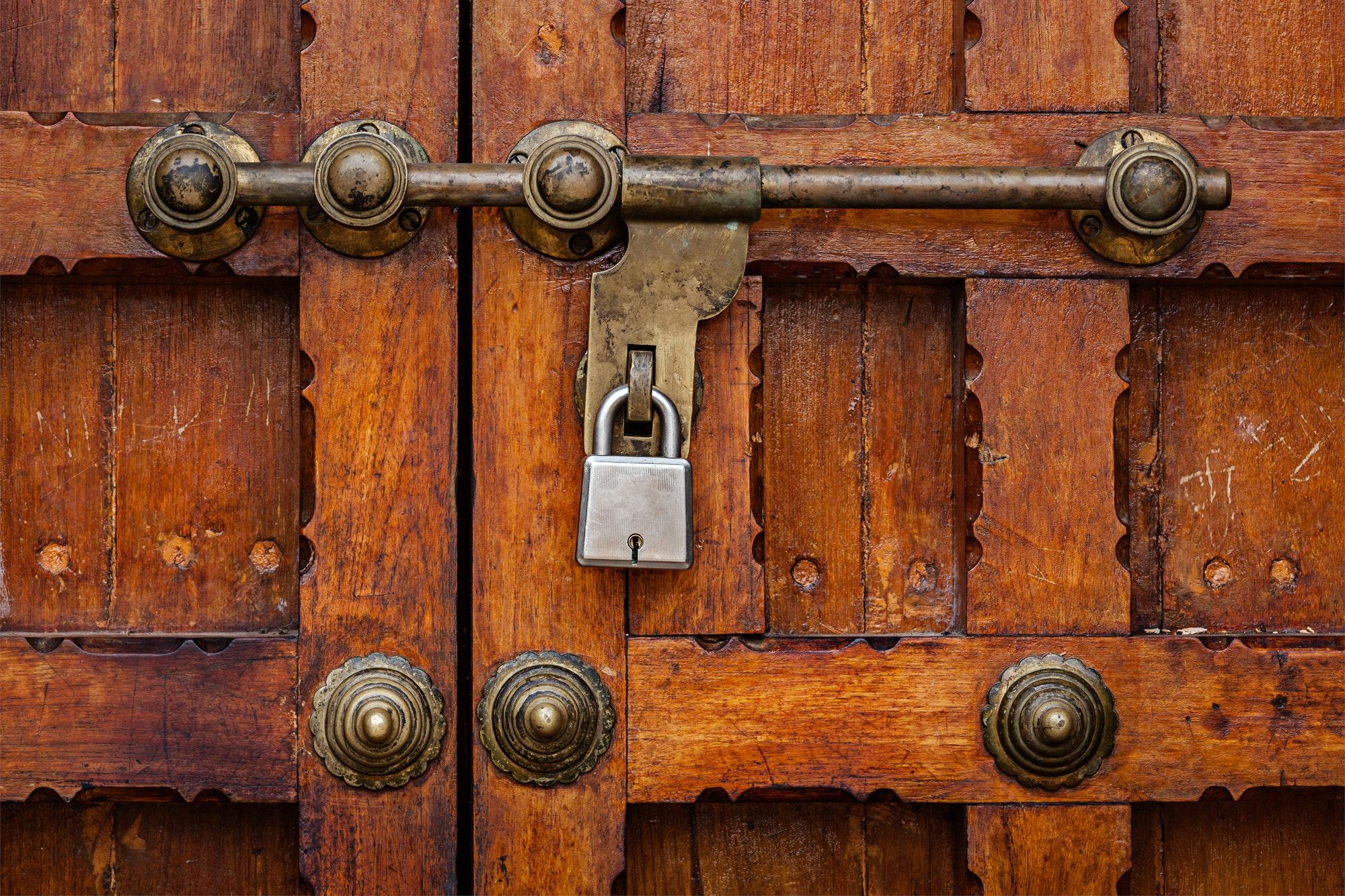 Latch with padlock on door